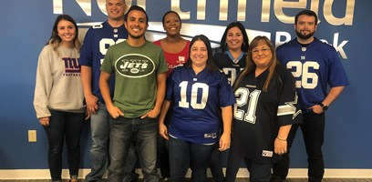 Northfield Bank employees dressed in their favorite football jersey to raise money for breast cancer awareness.